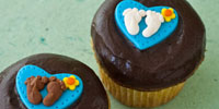 Custom-designed cupcakes for a boy-themed baby shower